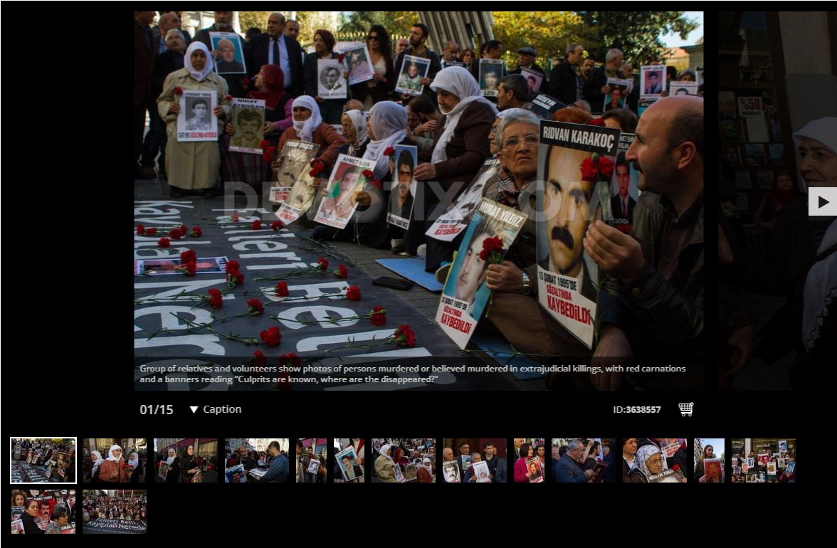 """Saturday Mothers"" show missing relatives' photos at rally in Istanbul"